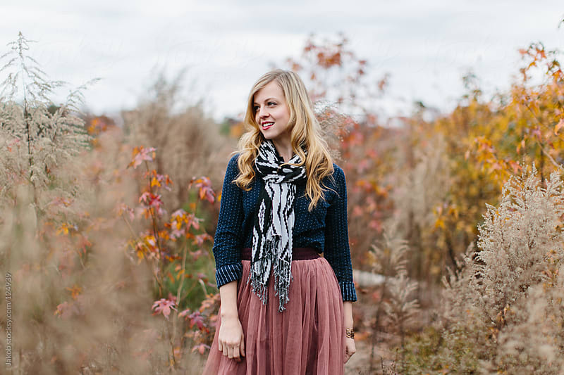 Portrait of a beautiful woman with wearing a trendy outfit by Jakob for Stocksy United