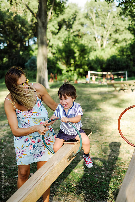 Mom and Son Playing in the Park by Aleksandra Jankovic for Stocksy United
