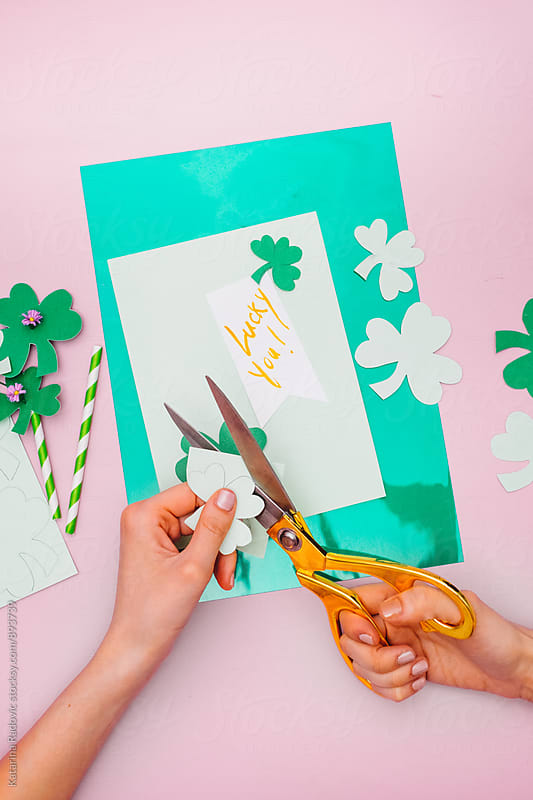 Woman Making Paper Shamrock as a Decoration for Saint Patrick's Day by Katarina Radovic for Stocksy United