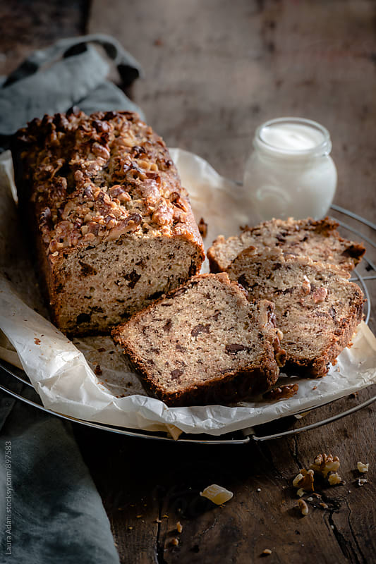 plumcake with banana, chocolate and hazelzut by Laura Adani for Stocksy United