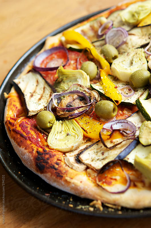 Mediterranean vegan pizza by Harald Walker for Stocksy United