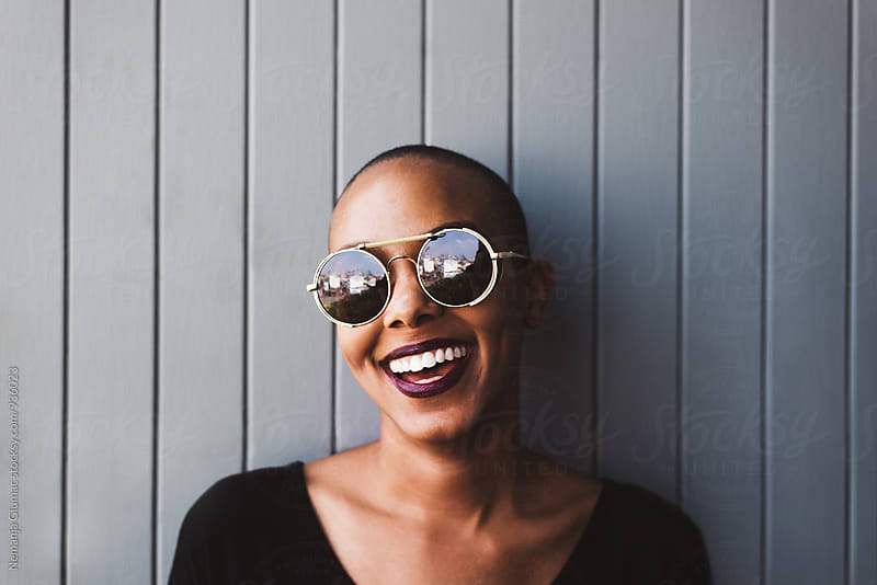 Smiling African American Woman With Shades by Nemanja Glumac for Stocksy United