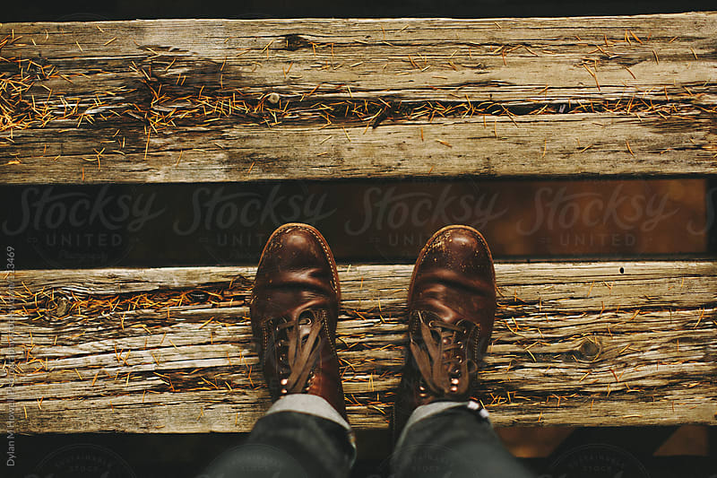 Boots on Railroad Tie by Dylan M Howell Photography for Stocksy United