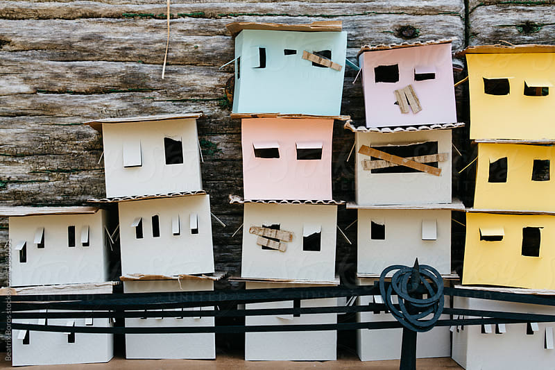 Houses in the slum with black electric cables made of cardboard by Beatrix Boros for Stocksy United