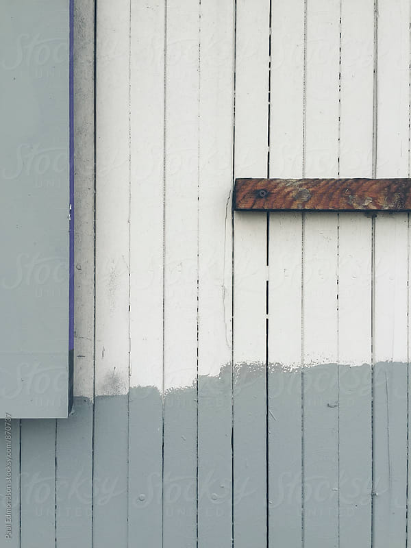 Detail of painted wood paneling on building wall by Paul Edmondson for Stocksy United