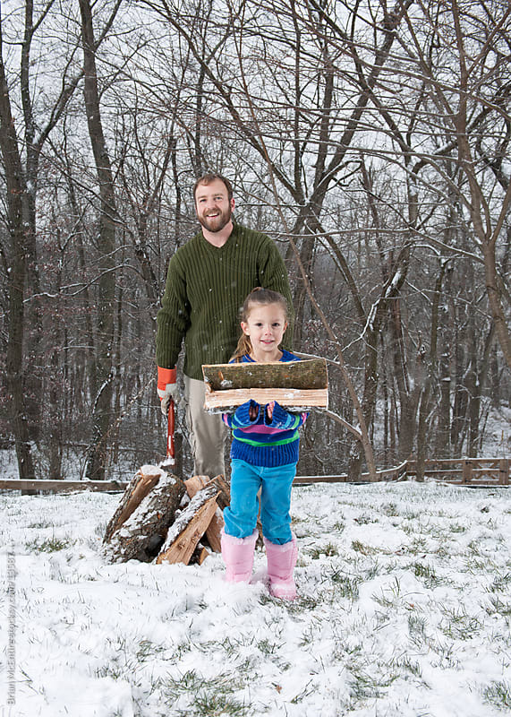 Splitting Firewood: Daughter Helps with Household Chores by Brian McEntire for Stocksy United