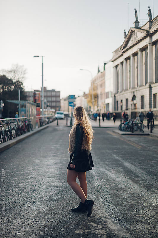 Woman Standing in the middle of the road by Good Vibrations Images for Stocksy United