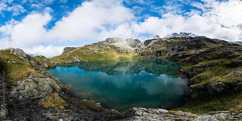 Milchspüeler mountain lake by Peter Wey for Stocksy United