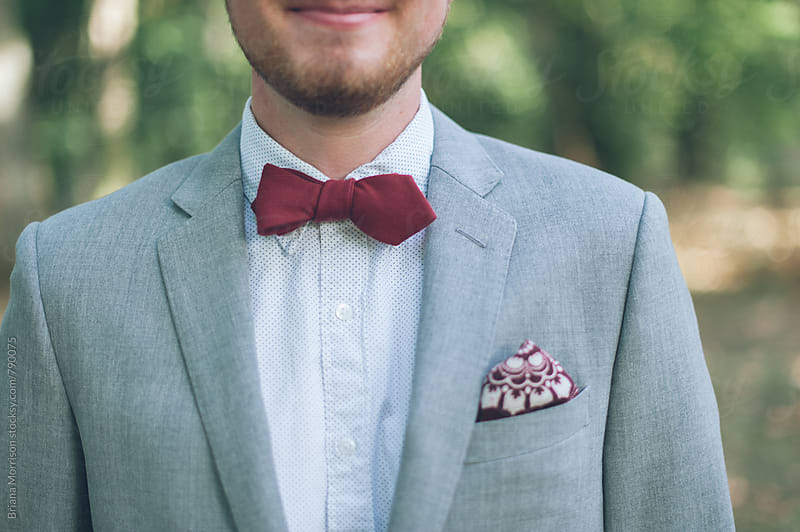 Close Up of a Man in A Suit and Bowtie by Briana Morrison for Stocksy United