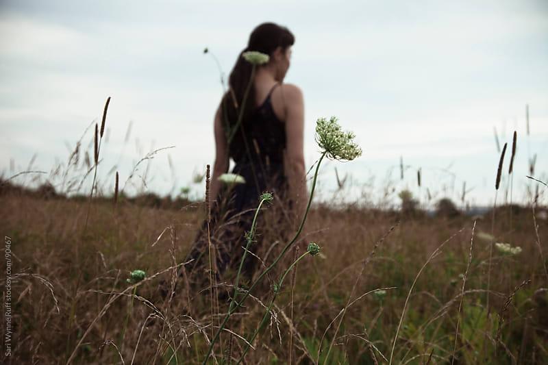 Girl Walking through field by Sari Wynne Ruff for Stocksy United