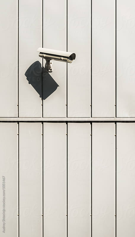 Detail on facade with security camera. by Audrey Shtecinjo for Stocksy United
