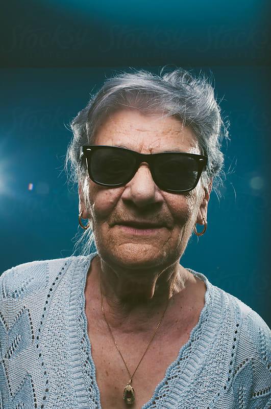Cool senior woman with sunglasses by Branislav Jovanović for Stocksy United