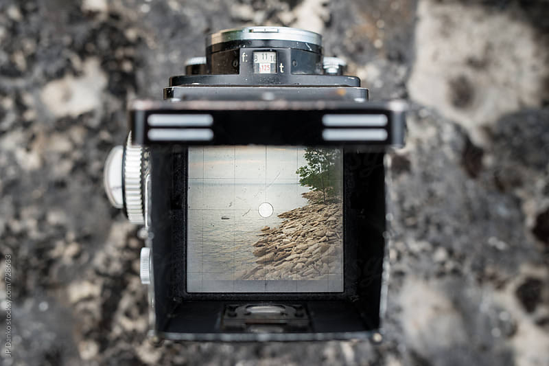 Viewfinder of Vintage Twin Lens Reflex Camera of Rugged Northern Beach Lakeshore by JP Danko for Stocksy United