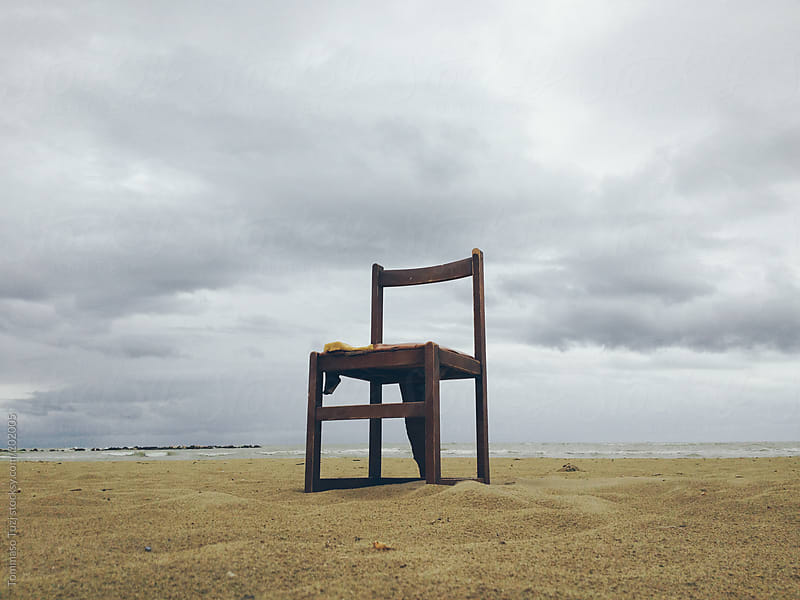 chair on the beach by Tommaso Tuzj for Stocksy United