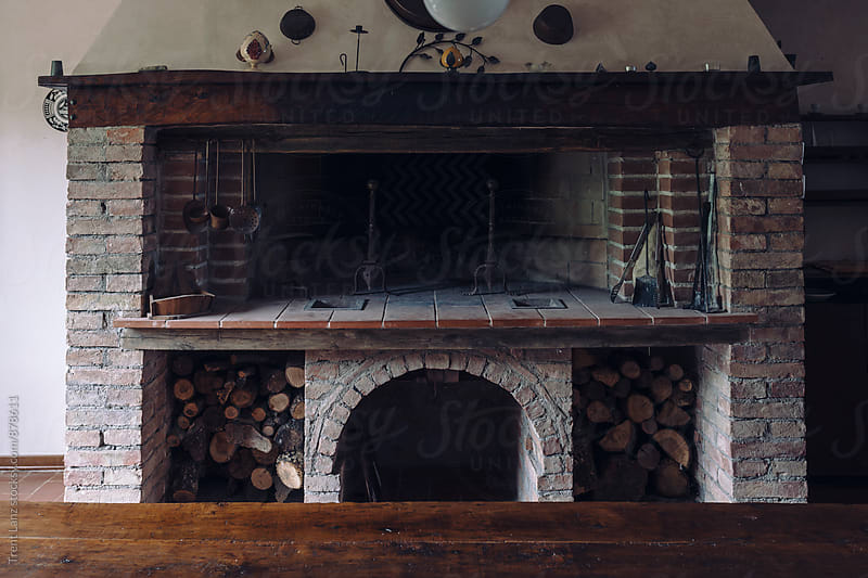 View on fireplace at Tuscan villa farhouse by Trent Lanz for Stocksy United