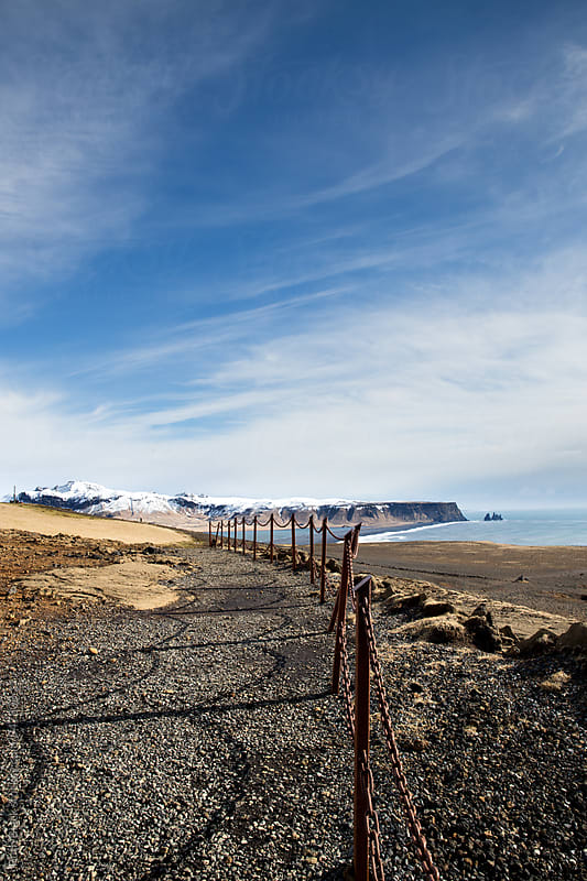 Coastal path with view of Reynisdrangar Sea Stacks in Iceland by Ruth Black for Stocksy United