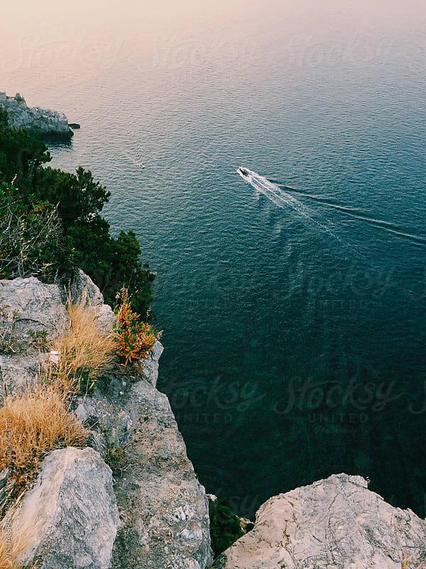 Overhead Shot of Boat Cruising Along Mediterranean Coast by VISUALSPECTRUM for Stocksy United