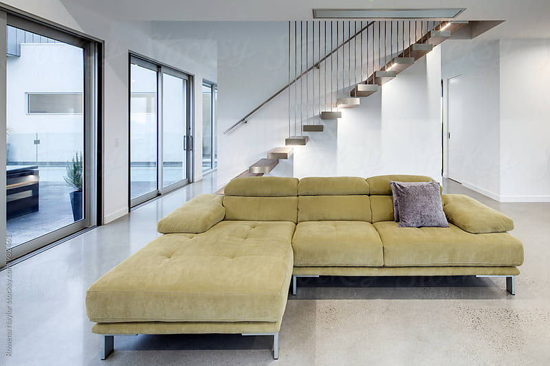 Architect designed home with floating staircase by Rowena Naylor for Stocksy United