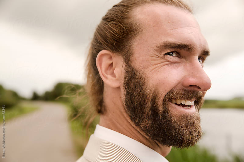close up of man smiling by Shaun Robinson for Stocksy United