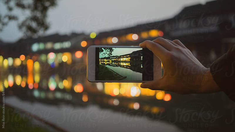 Chinese traditional water town,the world heritage,on a phone.XiTang,YongJia,ZheJiang,China by Miss Rein for Stocksy United