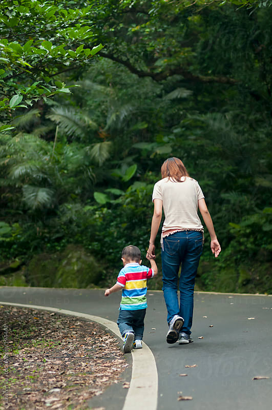 Mother and son walking in the mountain by Lawren Lu for Stocksy United
