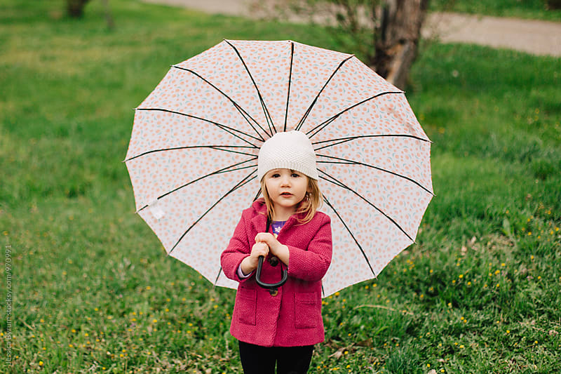 Little Girl, Big Umbrella by Jessica Byrum for Stocksy United