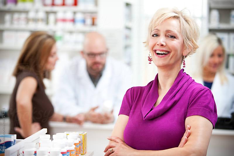 Pharmacy: Cheerful Pharmacy Shopper by Sean Locke for Stocksy United