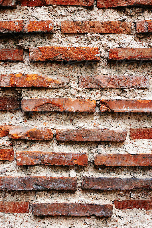 old brick wall by Atakan-Erkut Uzun for Stocksy United