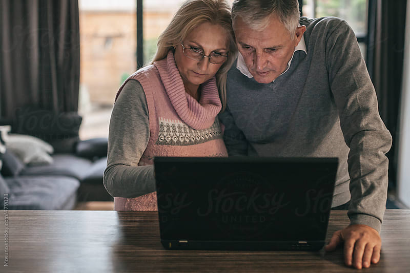 Senior Couple Using Laptop by Mosuno for Stocksy United