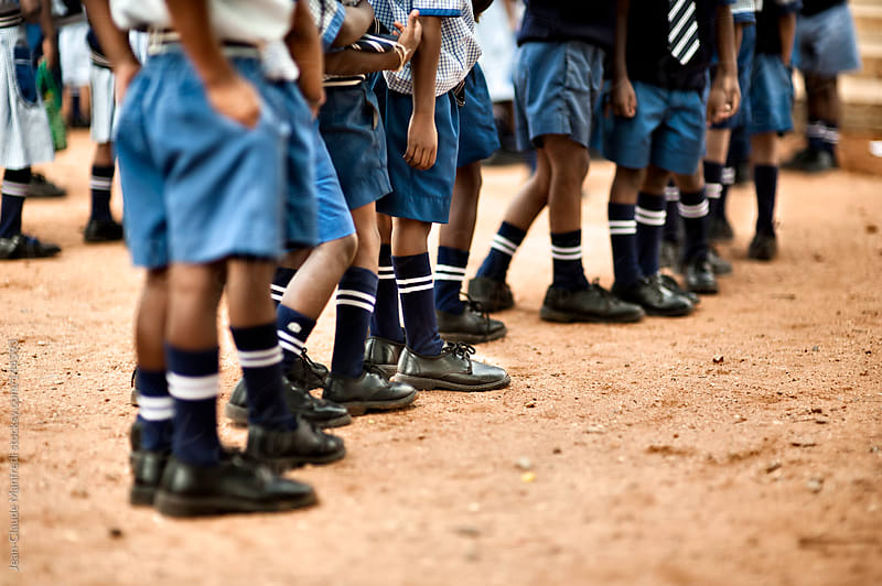 Children in uniform lined up in a boarding school before classes by Jean-Claude Manfredi for Stocksy United