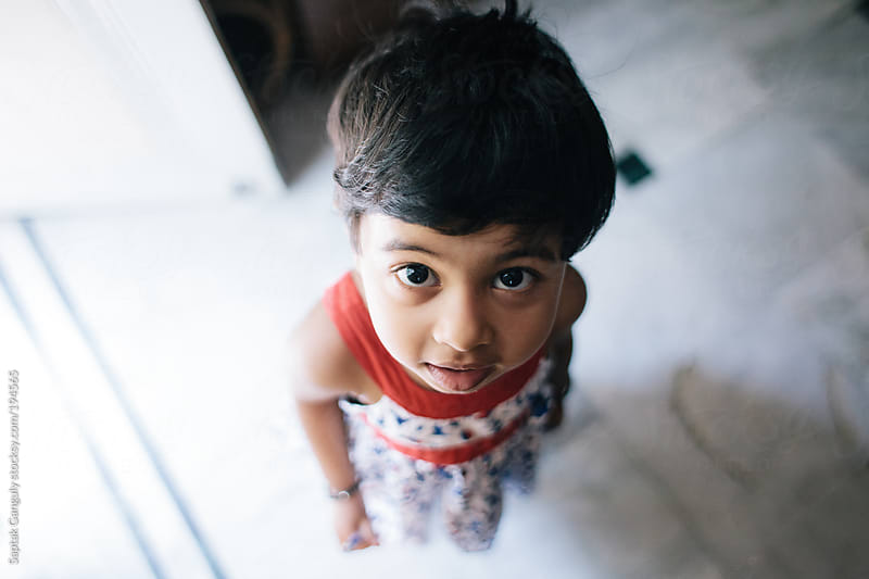 Cute toddler looking up at the camera by Saptak Ganguly for Stocksy United