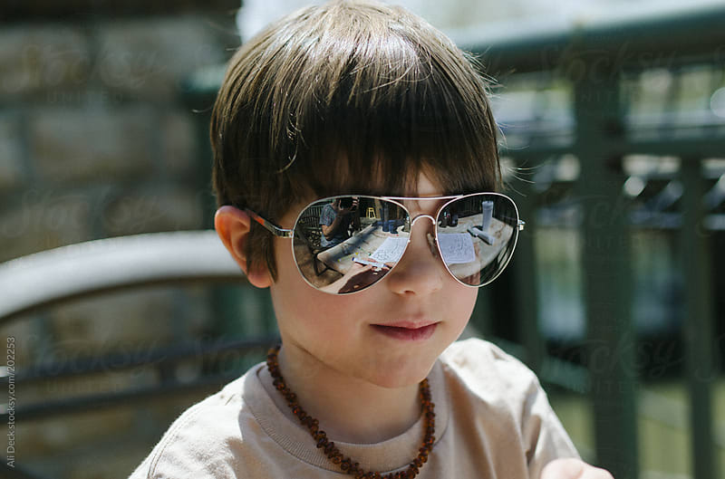 Boy in Sunglasses by Ali Deck for Stocksy United