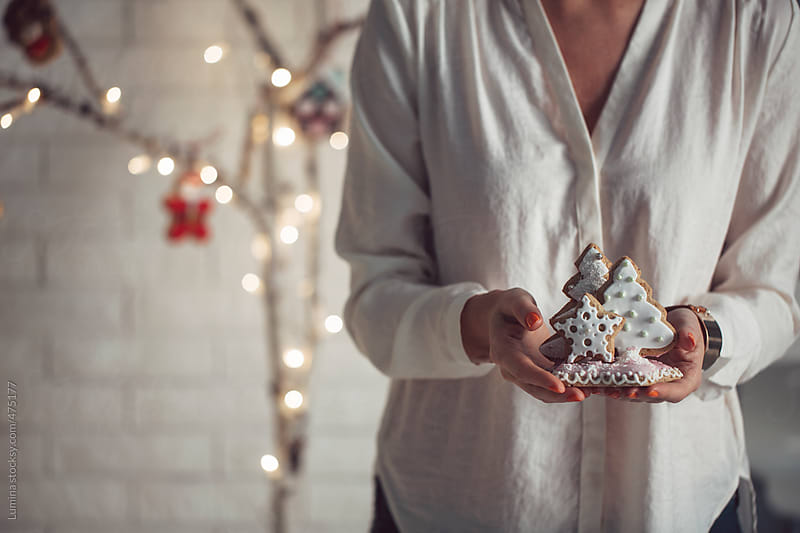 Woman Holding a Gingerbread Christmas Tree by Lumina for Stocksy United