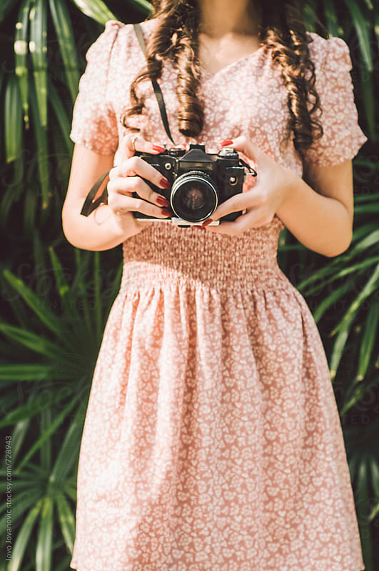 Girl holding an analog camera by Jovo Jovanovic for Stocksy United