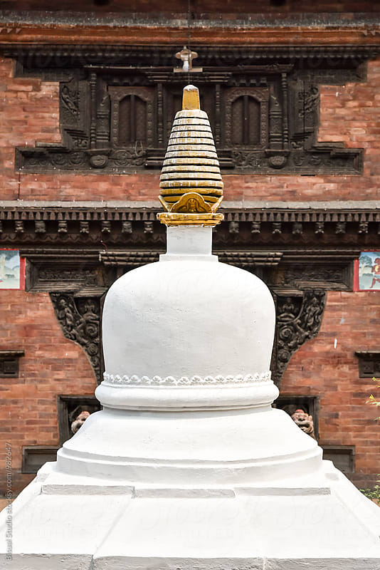 White stupa in the courtyard of a temple in Bhaktapur by Bisual Studio for Stocksy United