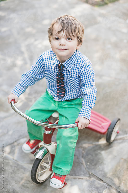 Dapper Toddler Boy On His Tricycle by Cameron Whitman for Stocksy United
