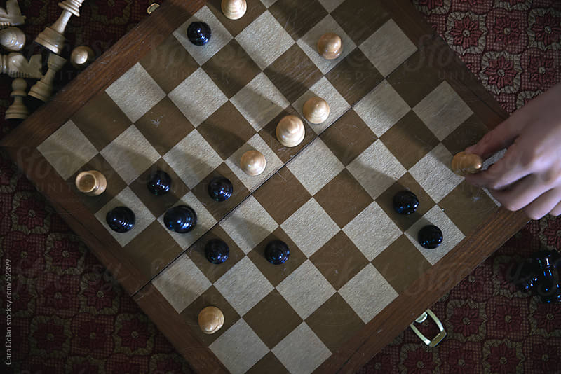 Game of chess in progress by Cara Dolan for Stocksy United