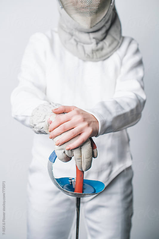 Woman in fencing costume holding sabre by Danil Nevsky for Stocksy United