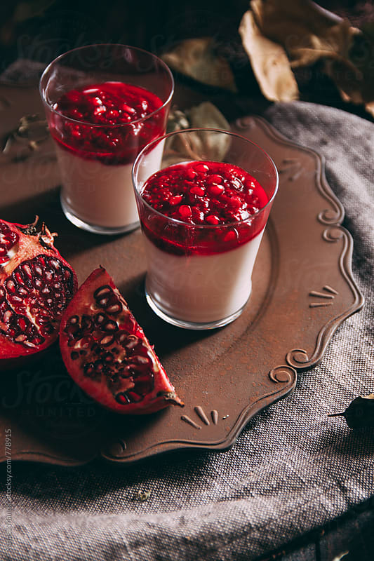 Pannacotta with pomegranate by Nataša Mandić for Stocksy United