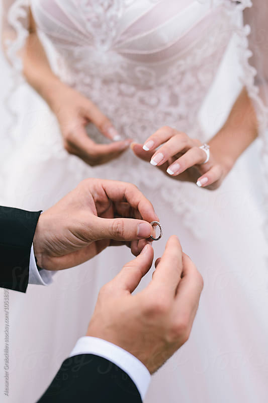 Wedding Ceremony. Exchange of Rings by Alexander Grabchilev for Stocksy United