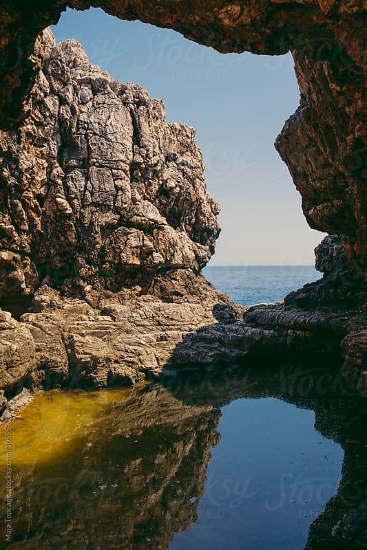 Hidden cave in Dubrovnik by Maja Topcagic for Stocksy United