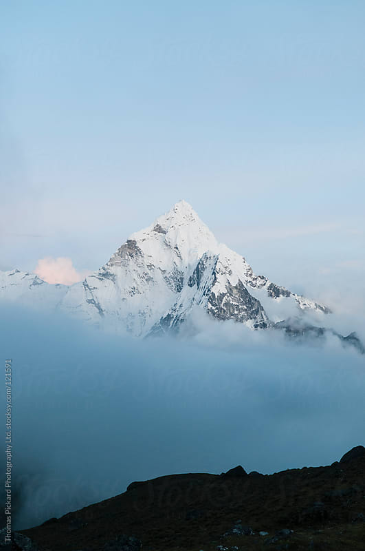 Cloud and mountain, Everest Region, Sagarmatha National Park, Nepal. by Thomas Pickard Photography Ltd. for Stocksy United