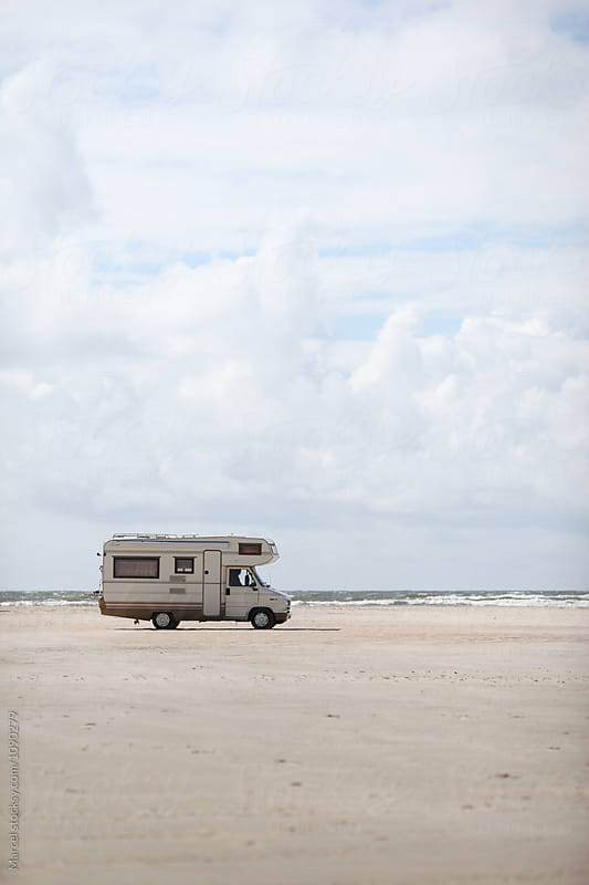 Camper on the beach by Marcel for Stocksy United