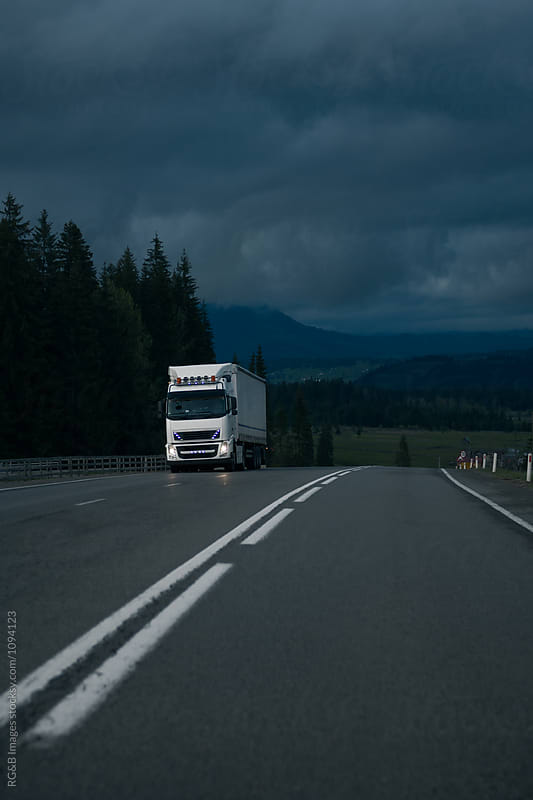 Transportation truck on the road at dawn