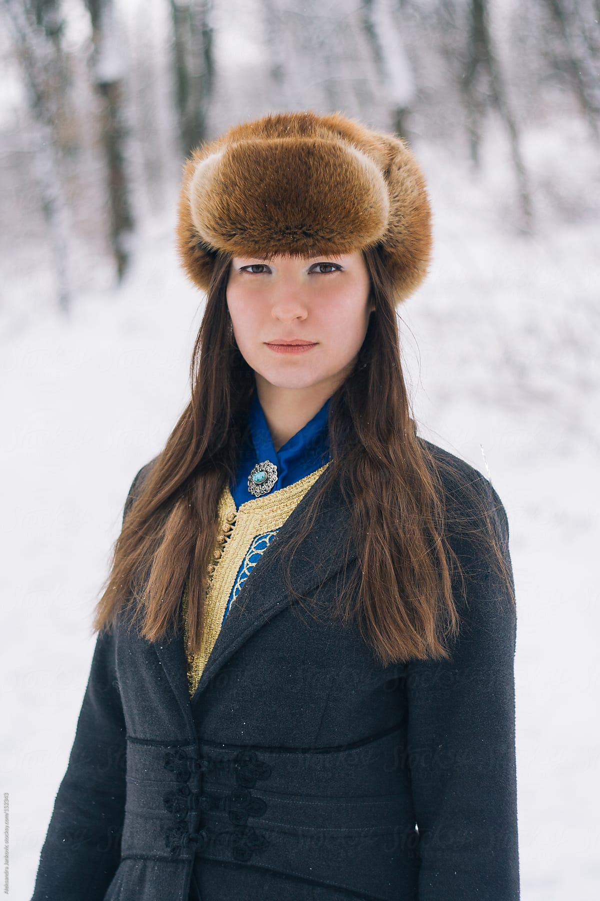 Stock Photo Portrait Of Beautiful Woman Wearing Fur Hat At Wintertime