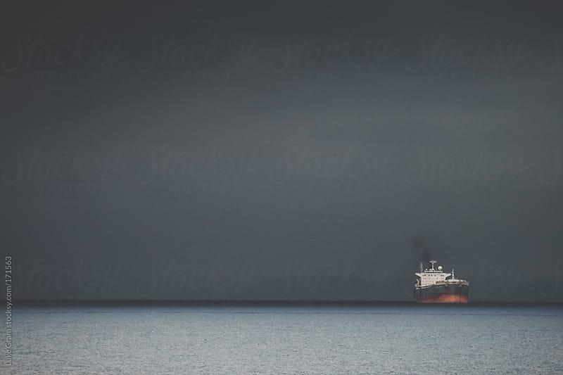 Ship coming into port by Luke Gram for Stocksy United