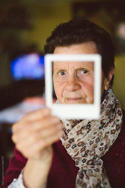 Senior woman portrait with polaroid frame by GIC for Stocksy United