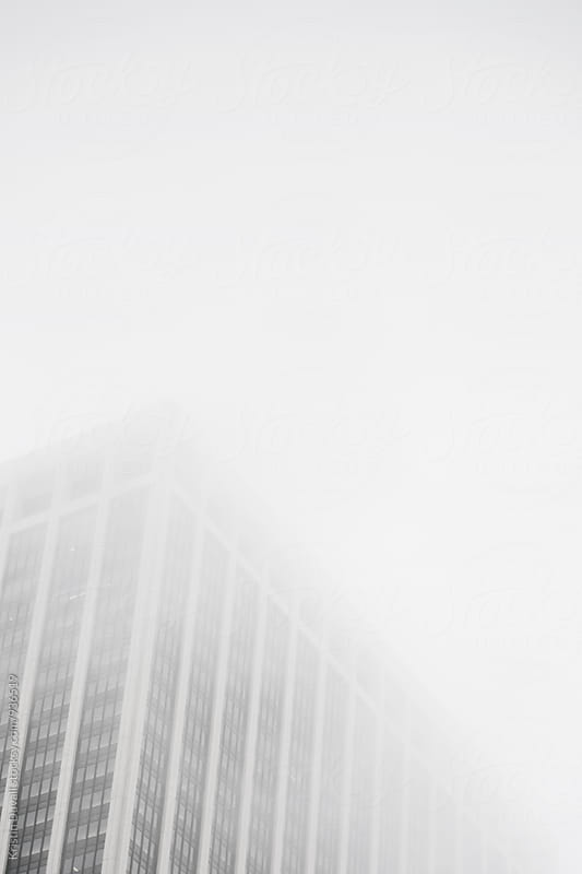 Modern building in fog by Kristin Duvall for Stocksy United