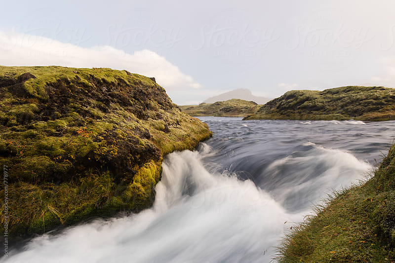 Water flowing through a small inlet  by Jonatan Hedberg for Stocksy United