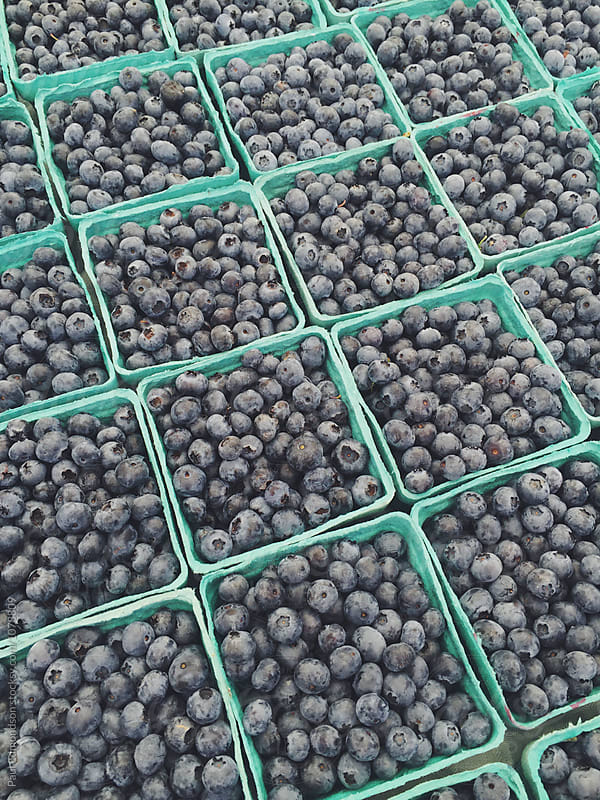 Blueberries for sale at farmer's market, close up by Paul Edmondson for Stocksy United